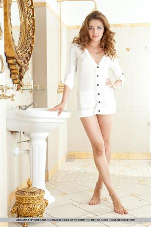 Adriana F nude in the bathroom posing by a white sink