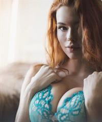 Sabrina Lynn in lingerie taking a selfie