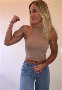 Emma Hartley flexing her bicep