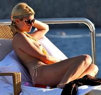 Paris Hilton nude tanning caught topless by paparazzi with her boobs exposed.