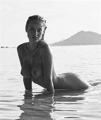 Genevieve Morton nude photo shoot in the water showing her naked boobs.