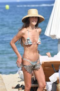 Maggie Q sexy ass in a thong bikini at the beach seen by paparazzi.