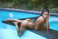 Sara Sampaio topless new photoshoot wet on the edge of the pool covering her nude boobs and sexy ass in thong bikini bottoms.