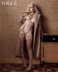 Billie Eilish boobs showing nice cleavage with her famous big tits and sexy legs in hot lingerie for a Vogue photoshoot.