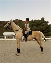 Riding her Horse
